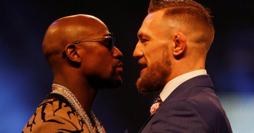 Floyd Mayweather Jr sekä Conor McGregor uhittelevat ottelun tiedotustilaisuudessa kansainväliseen tyyliin.