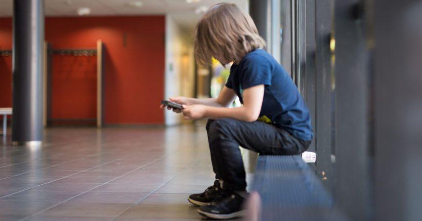 Nuoret, joilla ei ole kalliita puhelimia tai merkkivaatteita, voivat joutua aiempaa helpommin kiusatuiksi.